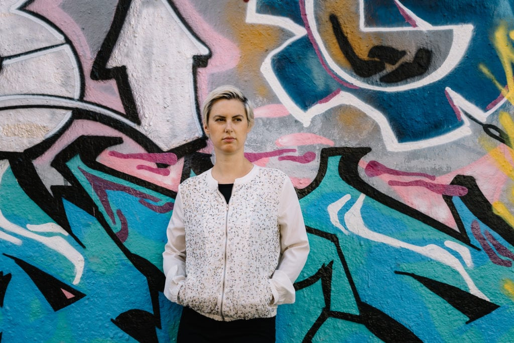 Not a cute girl pic but me leaning against a wall with graffitis shot by Antonia for my Personal Branding Page.